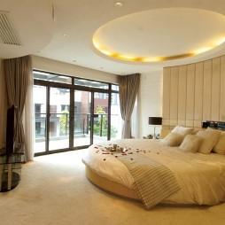 简单浪漫婚房卧室圆形床图片