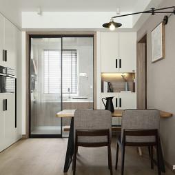 现代中性风格三居厨房餐厅区设计图
